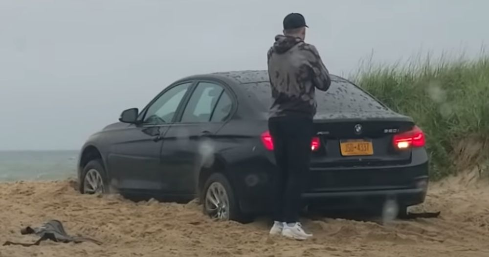 BMW - Man Leaves Beached BMW In Reverse Then Locks Himself Out - News