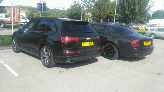 A blacked out Rolls Royce Ghost, and an Audi SQ7