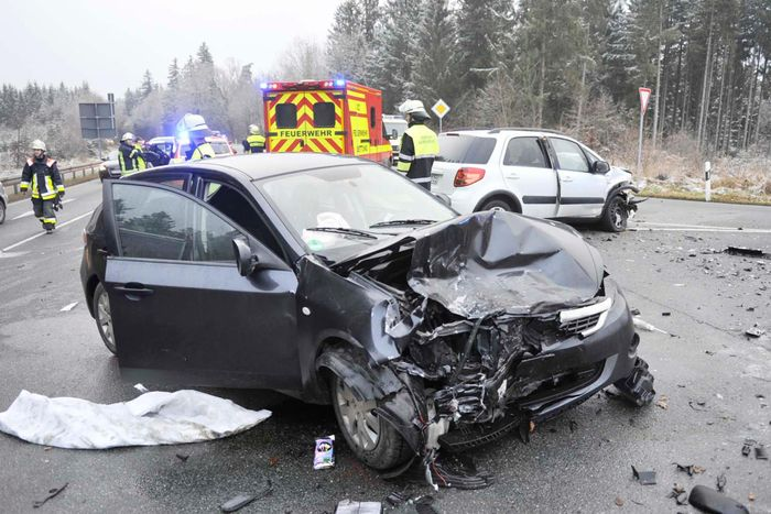 this is the car they were in a subaru impreza hatchback in the background you can see the suzuki sx4 which crashed into them