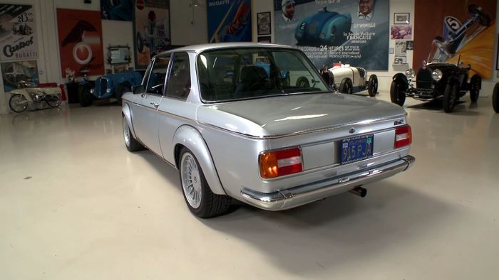 2002 s14 jay lenos welcomes a restomod bmw 2002 into his garage