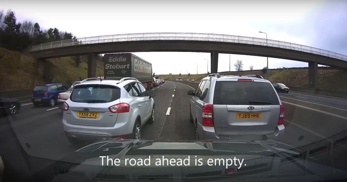 Watch Two Idiot Drivers Block Half A Motorway For No Damn Reason