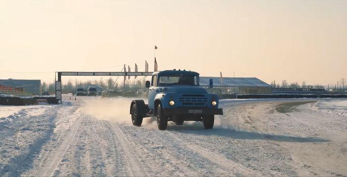 Watch An Old Soviet Truck Out-Drag A Porsche Cayman