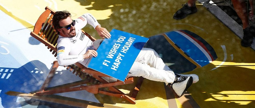 Alonso Watches F1 Podium From Deckchair, Next To A Painting Of His Meme