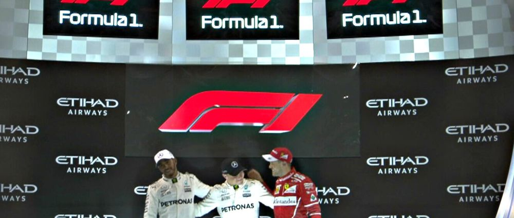 F1 Reveals New Logo On Abu Dhabi Podium