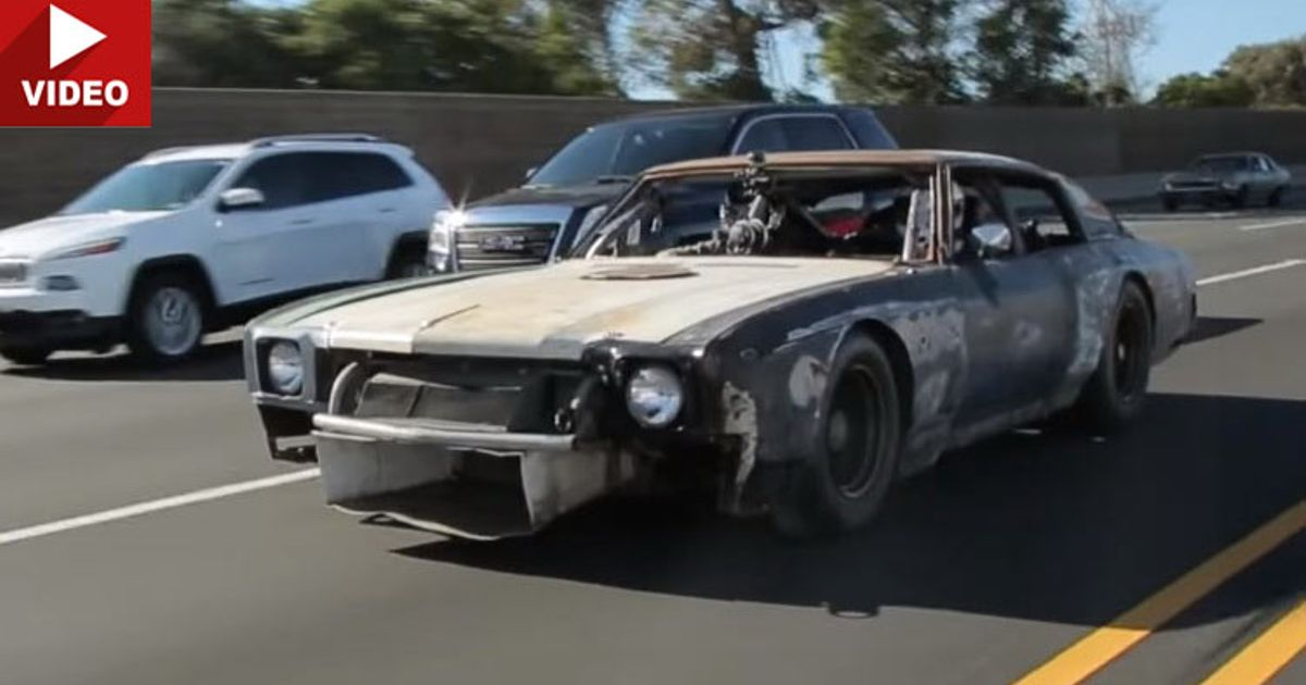 Muscle Cars Racing On Highway