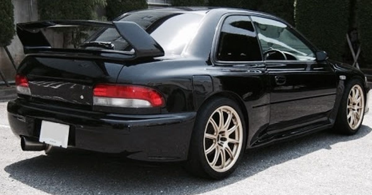 A black Subaru Impreza GC8 STI with a 22b widebody  I think