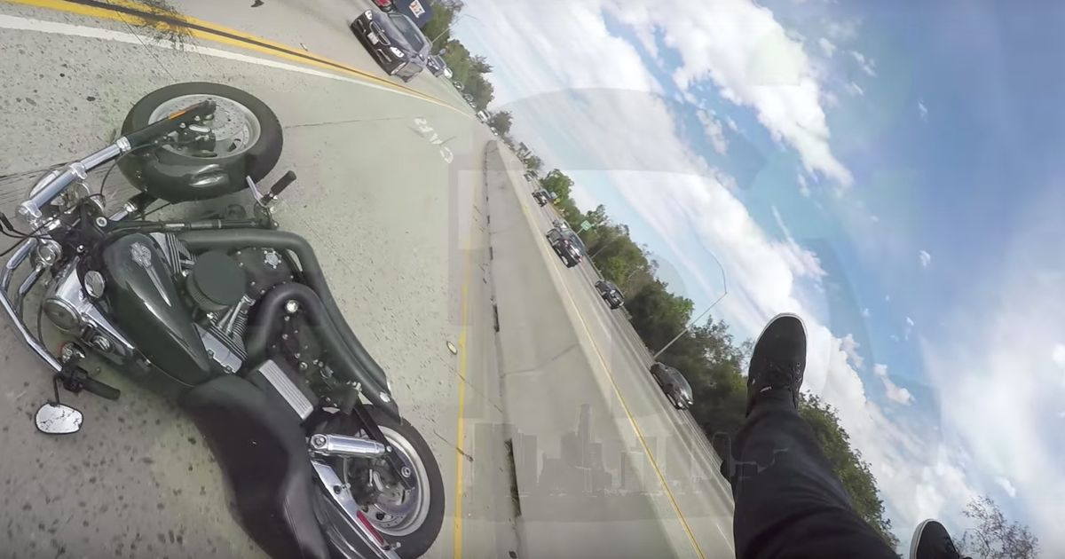Biker Wiped Out And Left Clinging To Back Of Car In Scary Crash