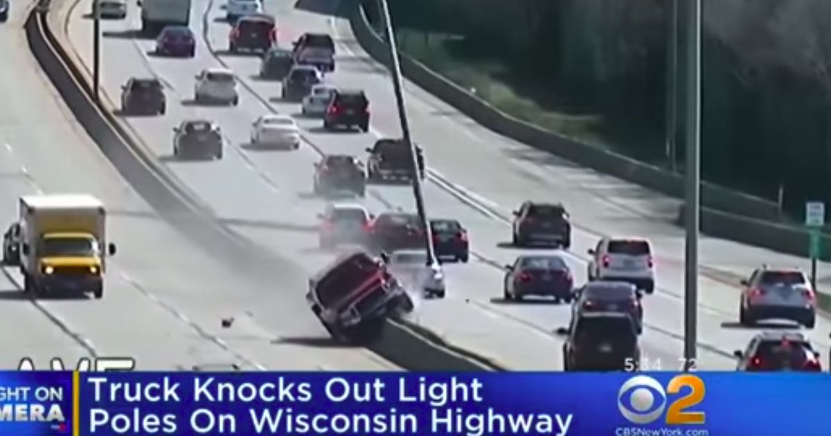 Watch This Pickup Wipe Out Two Freeway Lamp Posts, GTA Style