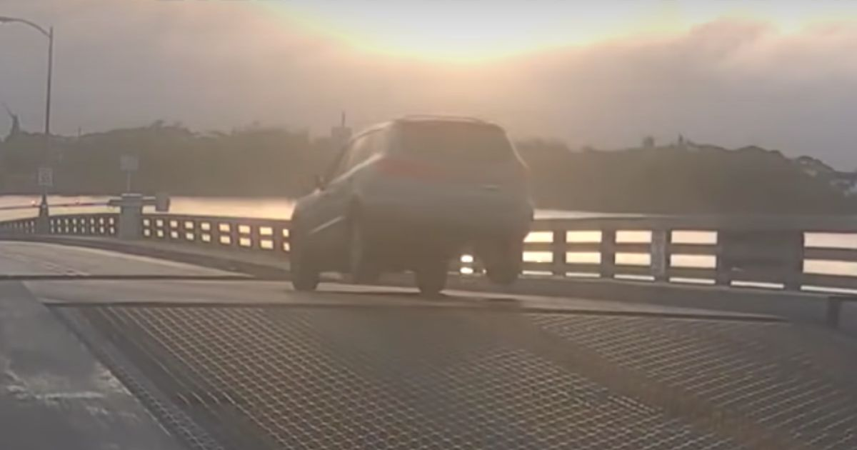 CCTV Footage Shows Driver Jumping Rising Drawbridge